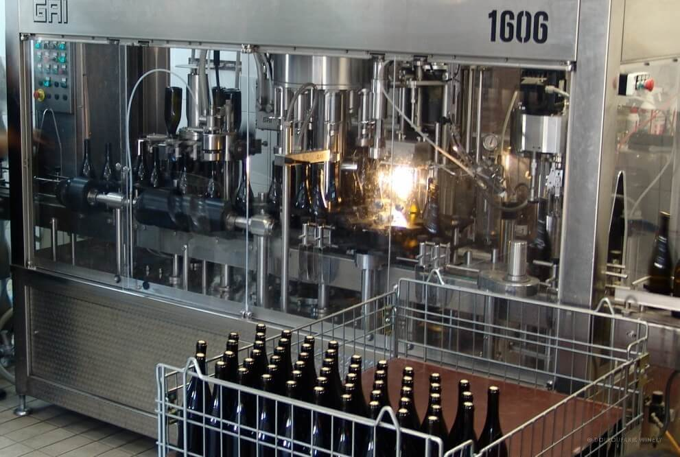 Automatic bottling line and labeling machines at the winery